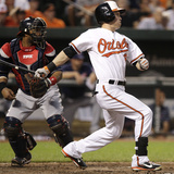 Baltimore, MD - June 27: Nate McLouth and Carlos Santana Photographic Print