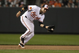 Baltimore, MD - June 27: Third baseman Ryan Flaherty and Carlos Santana Photographic Print