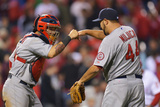 Philadelphia, PA - April 18: Yadier Molina and Edward Mujica Photographic Print