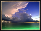 Lighting striking over green and blue water Framed Photographic Print by Richard Broadwell