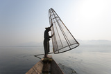 A Basket Fisherman on Inle Lake Prepares to Plunge a Cone Shaped Net Reproduction photographique par Alex Treadway