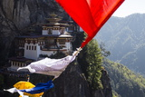 Prayer Flags Sway in the Wind Near Taktsang Monastery Photographic Print by Ira Block