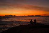 Early Risers Enjoy the Sunrise at Arpoador Rock Near Ipanema Beach Photographic Print by Eduardo Rubiano
