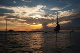 A Stilt Fisherman at Sunset Fotografisk tryk af Alex Saberi