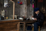 An Elderly Chinese Watchmaker Enjoys His Lunch of a Bowl of Noodles Photographic Print by Greg Davis