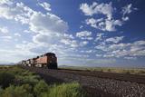 A Train Crossing the Landscape Fotografisk tryk af John Burcham