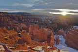 The Sun Rising Over Snow-dusted Hoodoos Photographic Print by Barrett Hedges