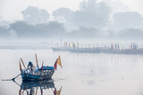 An Indian Man Rowing a Boat Across the Yamuna River in Morning Fog Photographic Print by Jonathan Kingston