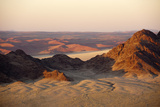 Light Illuminates the Naukluft Mountains and Namib Desert at Sunrise Photographic Print by Sergio Pitamitz