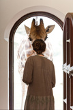 A Woman Greets a Rothschild Giraffe at the Door of a Lodge Photographic Print by Robin Moore