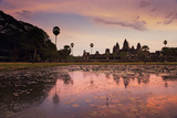 Sunrise Colors Reflect on a Lily Pad Filled Lake Fronting Angkor Wat Photographic Print by Jim Ricardson