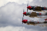 The Aerostars Perform at 250 Mph in 400-hp Yak 52TW Soviet Trainers Photographic Print by Robbie George