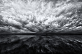 Heavy Dramatic Clouds and Their Reflection in Calm Water Photographic Print by Jonathan Irish