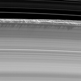 Towering Walls of Ice Rubble Cast Long Shadows on the Outer Edge of Saturn's B Ring Photographic Print by  NASA