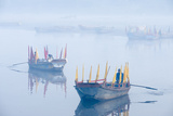 Rowboats with Colorful Flags in Fog at Sunrise on the Yamuna River Photographic Print by Jonathan Kingston
