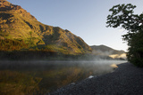 Steam Rises Off Two Medicine Lake As the Sun Starts to Rise Fotografisk tryk af Barrett Hedges