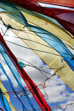 Colorful Tibetan Prayer Flags Fly Against a Blue Sky Photographic Print by Sean Gallagher