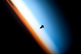 Earth's Sunlit Horizon Silhouettes the Space Shuttle ENDEAVOR in Orbit Photographic Print by  NASA