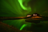 The Aurora Borealis Or Northern Lights Above a Hotel Photographic Print by Raul Touzon