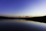 Reflections in a Calm Lake at Twilight Photographic Print by Jonathan Irish