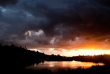 Sunlight and Storm Clouds Over Aqua Hedionda Lagoon in Carlsbad, California Photographic Print by Shannon Switzer