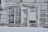 The Wooden Walls and Door of a Dilapidated Barn in Winter Photographic Print by Raul Touzon