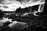 Heavy Clouds Over Oxararfoss Waterfall, and the Rocky Landscape Around It Photographic Print by Jonathan Irish