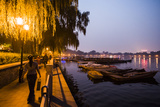 People Enjoy the Night Next to Houhai Lake Photographic Print by Jonathan Kingston