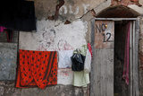 Colorful Laundry Brightens a Home in a Lane Near the Kalighat Temple Photographic Print by Steve Raymer