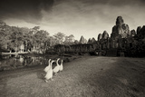 Geese Walk on the Grounds of the 12th Century Temple, Bayon Photographic Print by Jim Richardson