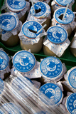 Milk Cartons Outside a Store in the Hutongs of Central Beijing, China Photographic Print by Sean Gallagher