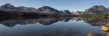 A Panoramic View of the Mountains Behind Saint Mary Lake Photographic Print by Barrett Hedges