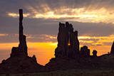 Silhouetted Totem Pole and Yei Bi Chei Rock Formations at Sunrise Photographic Print by Derek Von Briesen