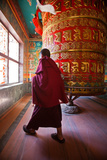 A Monk Spins the Worlds Largest Prayer Wheel Near Boudhanath Stupa Photographic Print by Ben Horton
