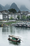 A Boat Crosses the Lijiang River on a Foggy Day in Yangshuo, China Photographic Print by Jonathan Kingston
