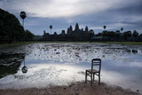 A Chair on the Shoreline of the Lake Fronting Angkor Wat Photographic Print by Jim Richardson