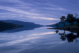 Loch Rannoch Casts a Mirror Reflection of Mountains, Sky, and Trees Photographic Print by Jim Richardson