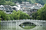 Stone Arch Bridge in Front of a Small Village Near Yangshuo, China Photographic Print by Jonathan Kingston
