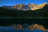 A Clear Lake Edged with Forests Near Latemar Mountain and the Dolomites Photographic Print by Babak Tafreshi