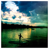 A Seven Year Old Girl Paddles a Paddle Board at Sunset on Sebago Lake Photographie par Skip Brown