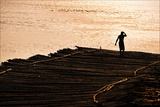 A Bamboo Raft Sways in the Tidal Flats of the Hooghly Rive Photographic Print by Steve Raymer