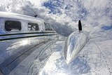 Robbie George - Clouds and Sky Reflecting Off the Shiny Silver Surface of An Airplane - Fotografik Baskı