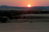 The Sun Sets Over Grasslands and Hills in the Torra Conservancy Photographic Print by Sergio Pitamitz
