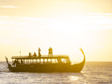 A Dhoni, a Traditional Boat, on a Sunset Cruise in the Maldives Photographic Print by Jad Davenport