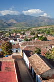 A Roof Top View of Trinidad's Tile Roofs and Surrounding Countryside Photographic Print by Dmitri Alexander