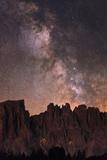 The Milky Way and Stars Above Latemar Mountain Photographic Print by Babak Tafreshi