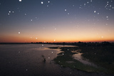 Thousand of Insects Flying Over the Chobe River at Sunset Photographic Print by Sergio Pitamitz