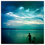 An Eight Year Old Boy Stands on a Dock on Sebago Lake at Sunset Photographic Print by Skip Brown