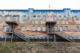 An Apartment Building Adorned with Colorful Murals Photographic Print by Sergio Pitamitz