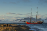 A Tall-masted Schooner, the Northern Light, Anchored Off a Beach Photographic Print by Ralph Lee Hopkins